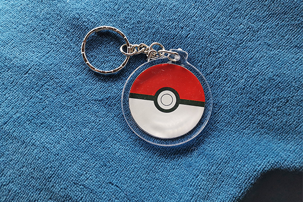 Chubbbys Eevee Evolution charm in pokeball form front side shows pokeball