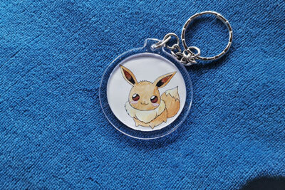 Chubbbys Eevee Evolution charm in pokeball form front side shows Eevee