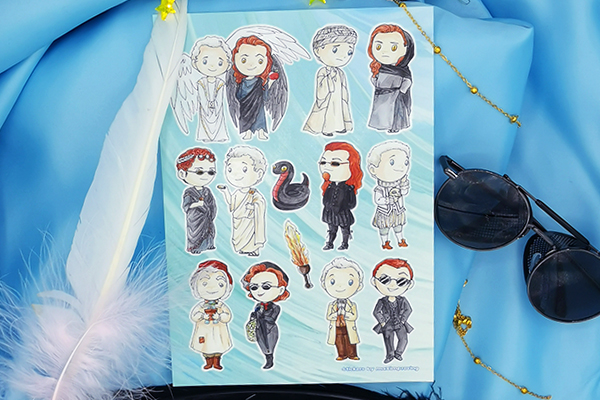 A5 sticker sheet with Ineffable Husbands Aziraphale and Crowley in various outfits through the ages