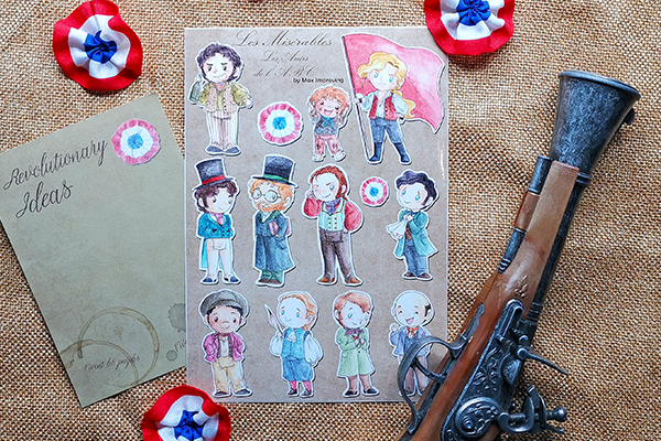 Les Miserables A 5 sticker sheet showing Enjolras Grantaire Gavroche Courfeyrac Combeferre Bahorel Marius Feuilly Jehan Jean Prouvaire Joly Bossuet Les Amis details shot
